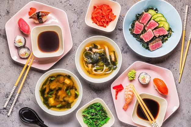 Table with traditional japanese food, top view.