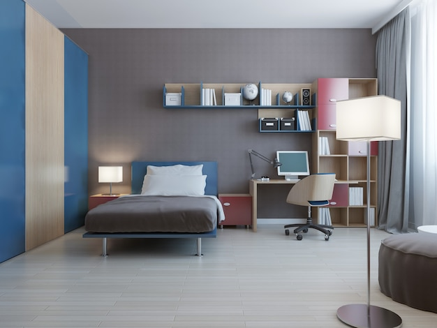 Table with wall system in modern bedroom with wall system in blue and red colors and dressed bed with pillows and large closet with blue sliding doors.