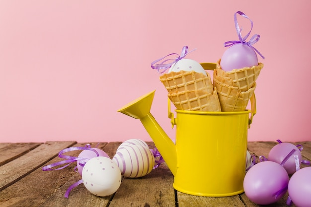 Table with watering can and easter eggs