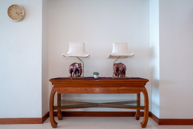 Table with wood elephant lamp