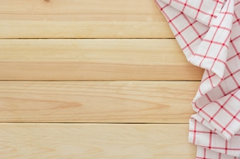 Tablecloth textile, checkered picnic napkin on wooden table background