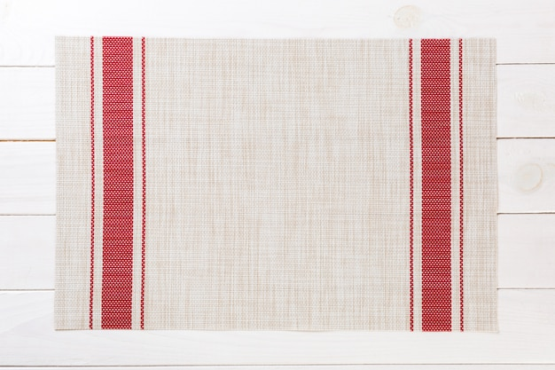 Tablecloth textile on wooden background top view with copy space