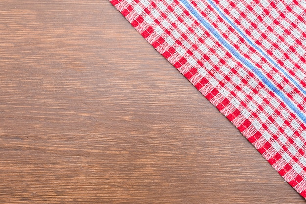 Tablecloth on wooden background