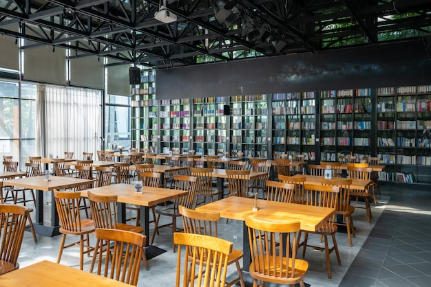 Tables and chairs are in the consumption area of the bookstore