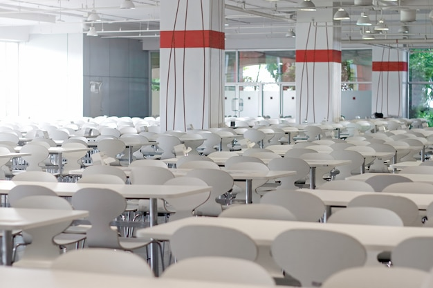 Tables and chairs on food court shopping mall.