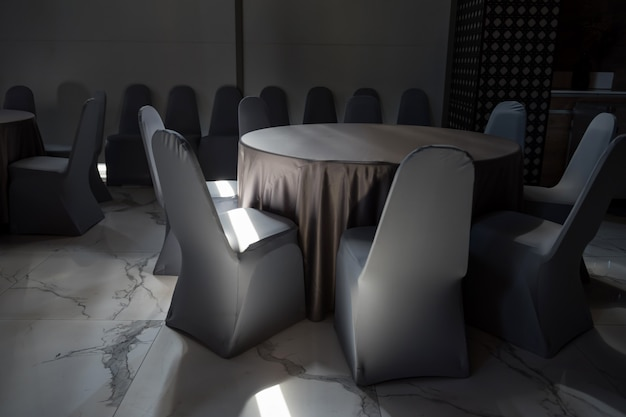 Tables and chairs in hotel restaurant