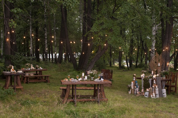 Tables set in forest
