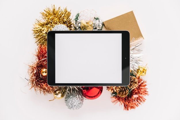 Tablet on baubles and spangles