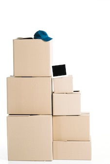 Tablet and cap on stack of boxes