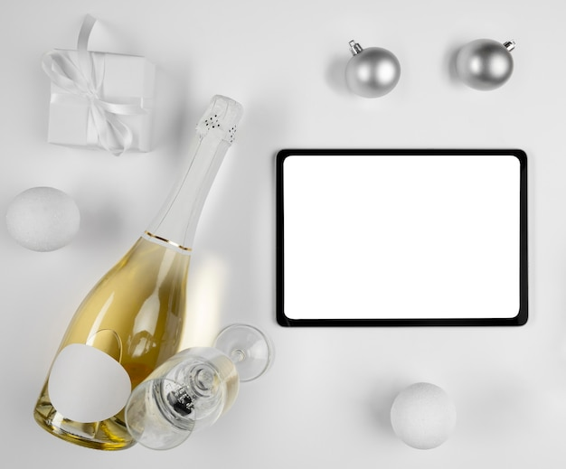 Tablet next to champagne bottle