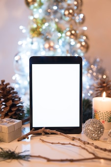 Tablet between christmas decorations