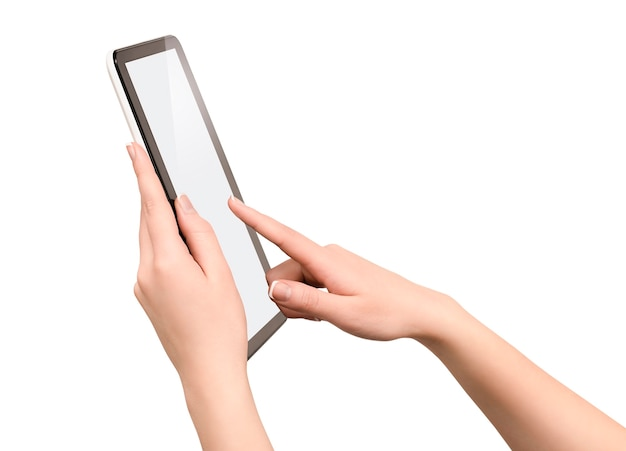 Tablet computer in female hands on isolated white wall