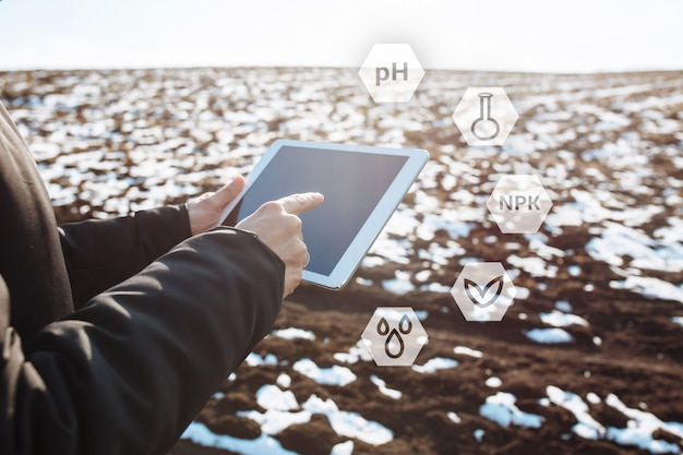 Tablet in the hands of a farmer checking the preparation process