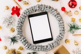 Tablet in silver wreath on table