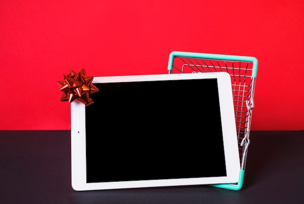 Tablet near toy shopping basket
