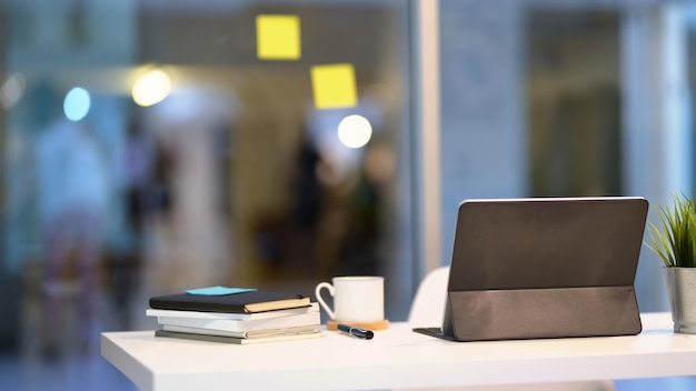 Tablet and office supplies in minimal workplace