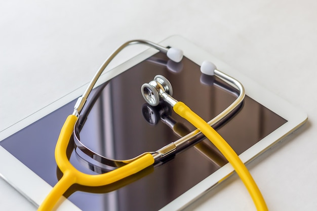 Tablet pc and stethoscope closeup.