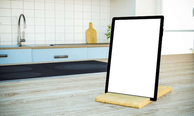Tablet pc with blank screen on cooking island at the kitchen