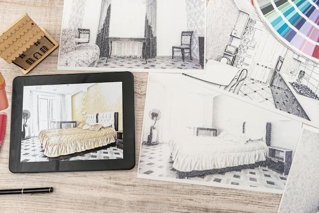完成した部屋の寝室の計画を示すタブレット。モダンなアパート。製図。家のインテリアデザイン、スケッチ