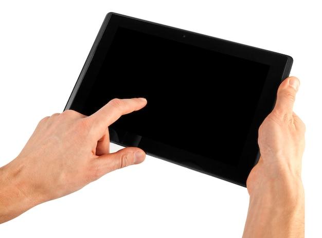 Tablet on white surface Premium Photo