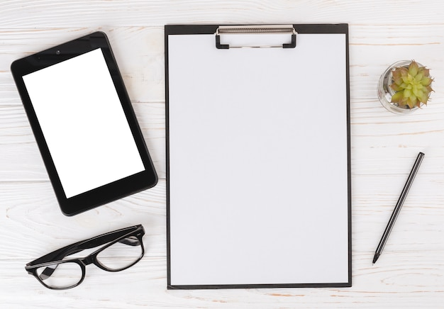 Tablet with blank clipboard on table
