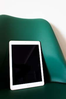 Tablet with blank screen on a chair