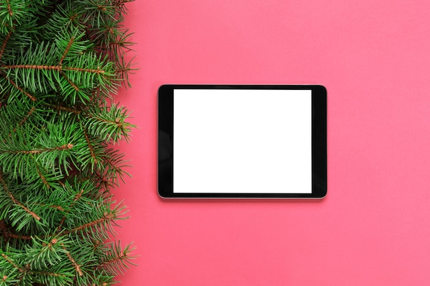 Tablet with blank screen on the pink pastel