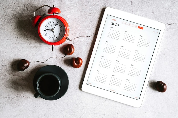 A tablet with an open calendar for 2021 year