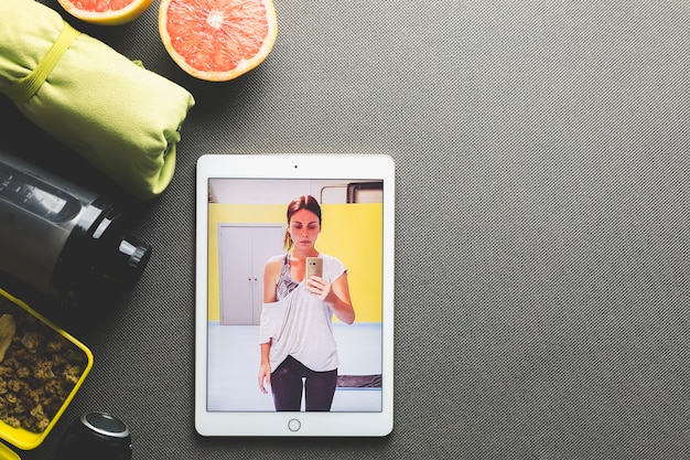 Tablet with photo near healthy food