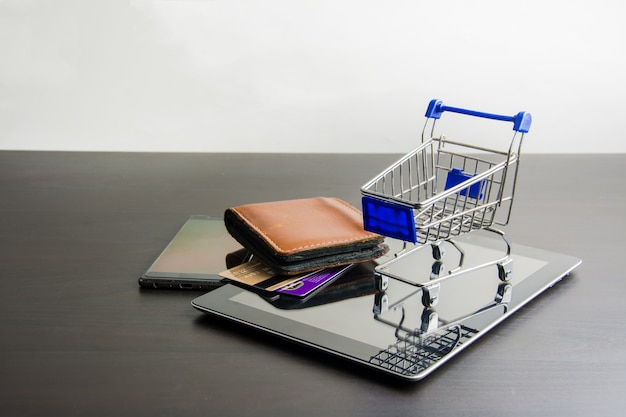 Tablet with shopping cart on wood