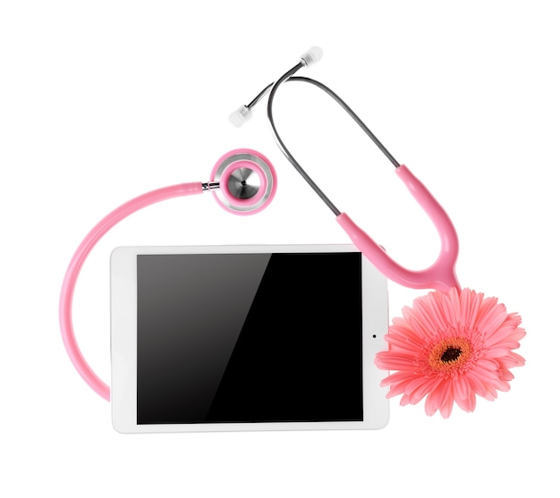 Tablet with stethoscope and flower on white