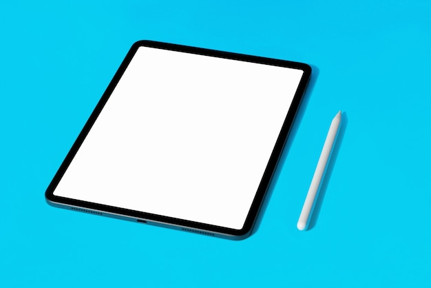 Tablet with white screen on eyllow color background with pencil