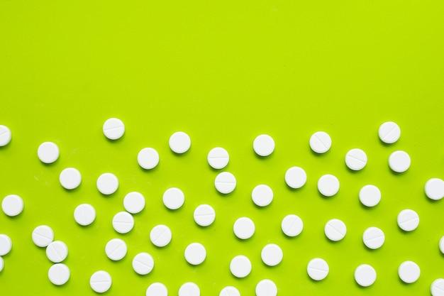 Tablets of paracetamol on green