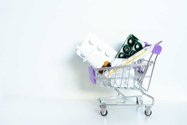 Tablets in a trolley on a white background copy space basket home delivery of medicines home