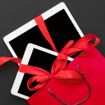 Tablets with ribbons in red packet