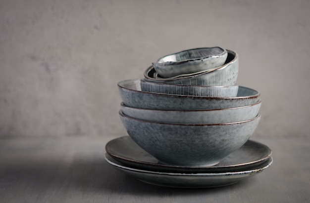 Tableware set on a gray background, selective focus, copy space.