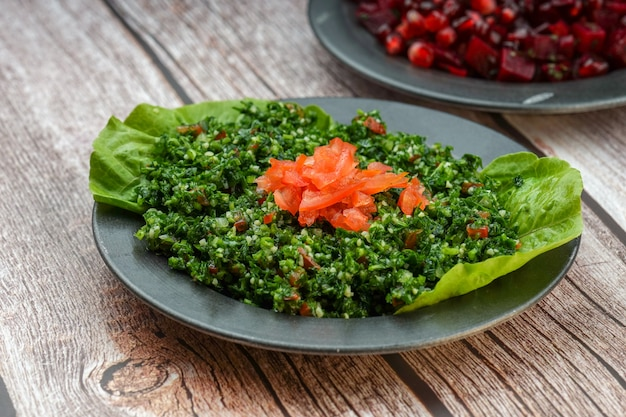 Tabouleh salad on a green plate