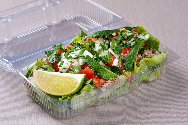 Tabule. refreshing salad from lebanese cuisine. package for delivery