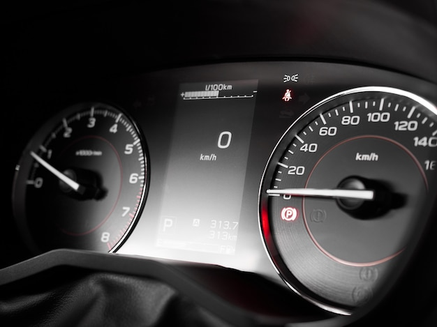 Tachometer rpm, speedometer, display close-up on dashboard in interior of modern car