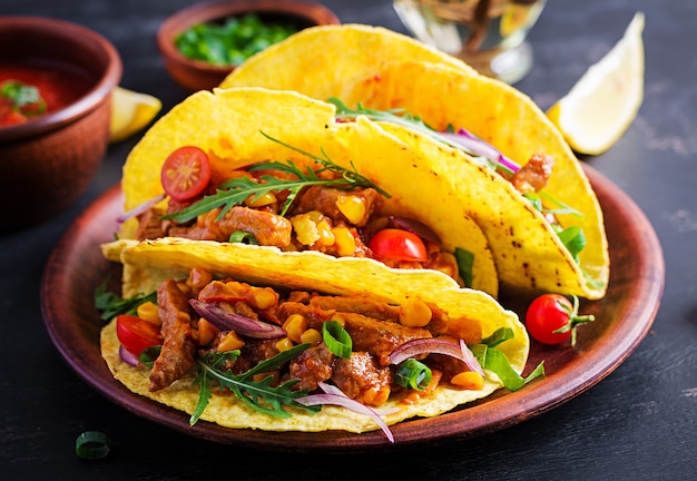 Taco. mexican tacos with beef meat, corn and salsa. mexican cuisine. copy space.
