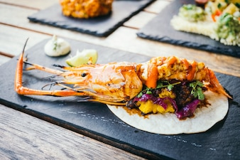 Taco with prawn or shrimp and sauce