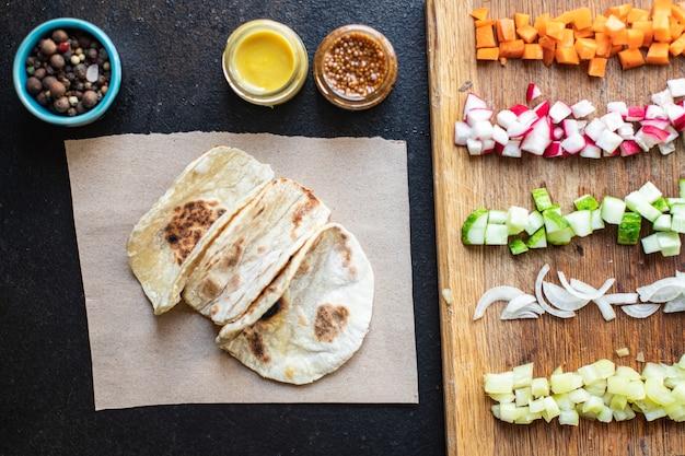 Tacos stuffed vegetables doner kebab flatbread vegetable taco on the table healthy food meal snack