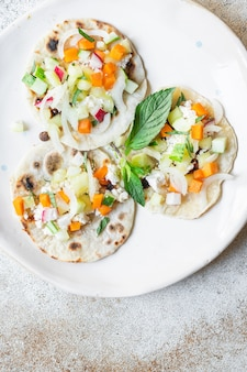 Tacos vegetable doner kebab flatbread taco on the table healthy meal snack copy space food