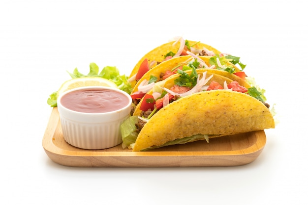Tacos with meat and vegetables isolated on white background