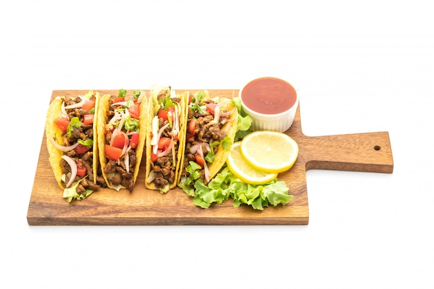 Tacos with meat and vegetables isolated on white