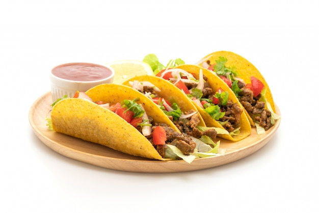 Tacos with meat and vegetables isolated