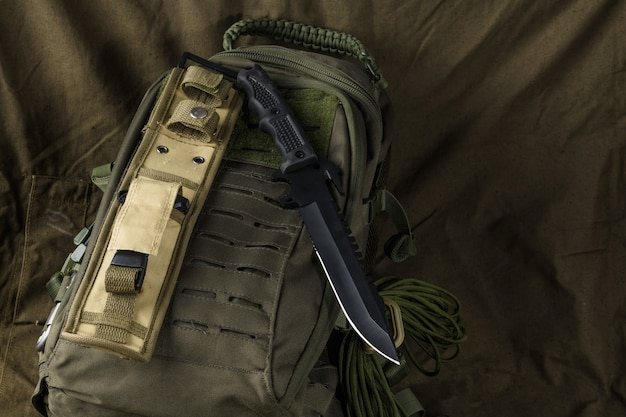 Tactical combat knife on a backpack