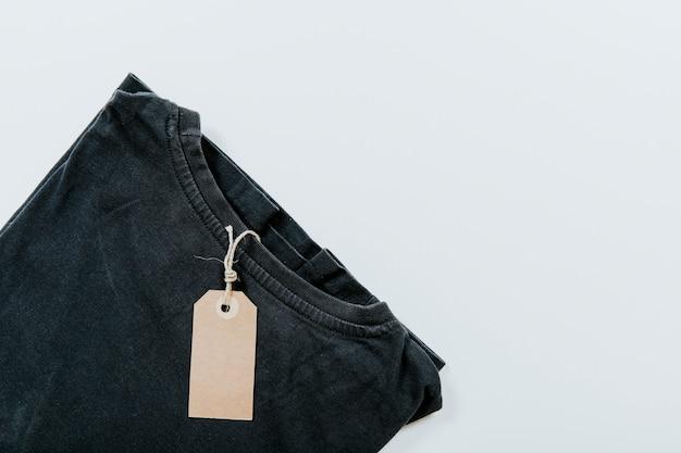 Tag on black t shirt