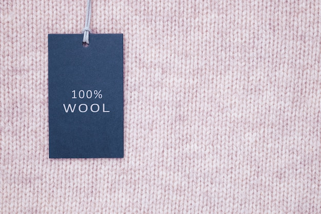 Tag composition of clothing on knitted texture background
