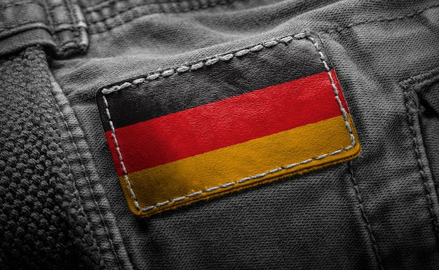 Tag on dark clothing in the form of flag of germany.